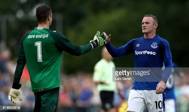 Wayne Rooney of Everton shakes hands with goalkeeper Jorn Brondeel of Twente during a preseason friendly match between FC Twente and Everton FC at...