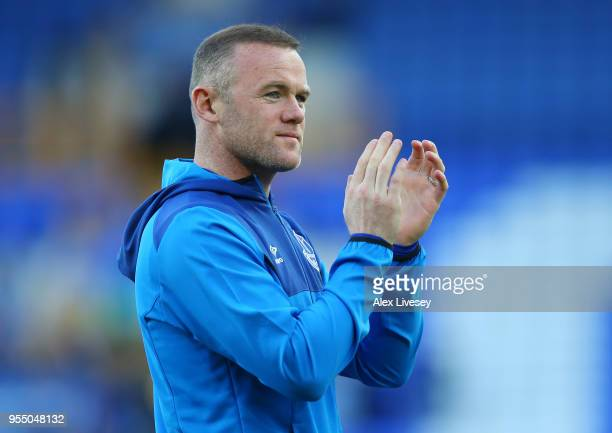 Wayne Rooney of Everton shows appreciation to the fans during the lap of honour after the Premier League match between Everton and Southampton at...