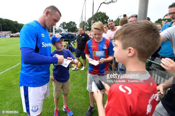 Wayne Rooney of Everton signs autographs before the preseason friendly match between FC Twente and Everton FC on July 19 2017 in De Lutte Netherlands