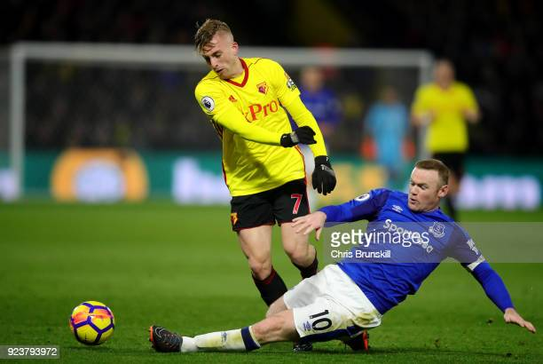 Wayne Rooney of Everton tackles Gerard Deulofeu of Watford during the Premier League match between Watford and Everton at Vicarage Road on February...
