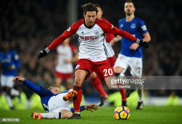 Wayne Rooney of Everton tackles Grzegorz Krychowiak of West Bromwich Albion during the Premier League match between Everton and West Bromwich Albion...
