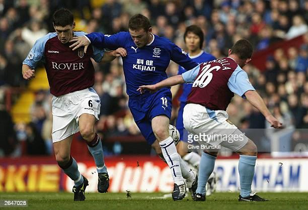 Wayne Rooney of Everton takes on Gareth Barry and Mark Kinsella of Aston Villa during the FA Barclaycard Premiership match between Aston Villa and...