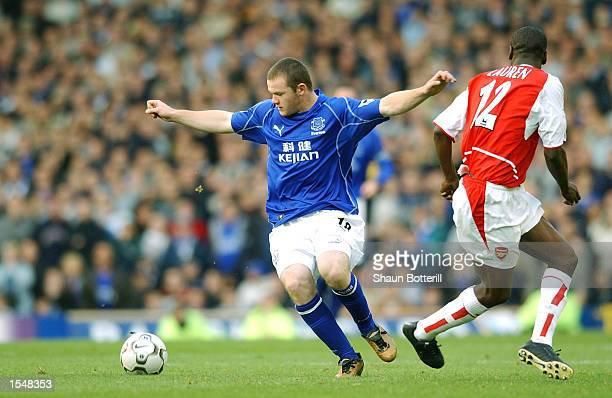 Wayne Rooney of Everton takes on Lauren of Arsenal during the FA Barclaycard Premiership match between Everton and Arsenal at Goodison Park in...