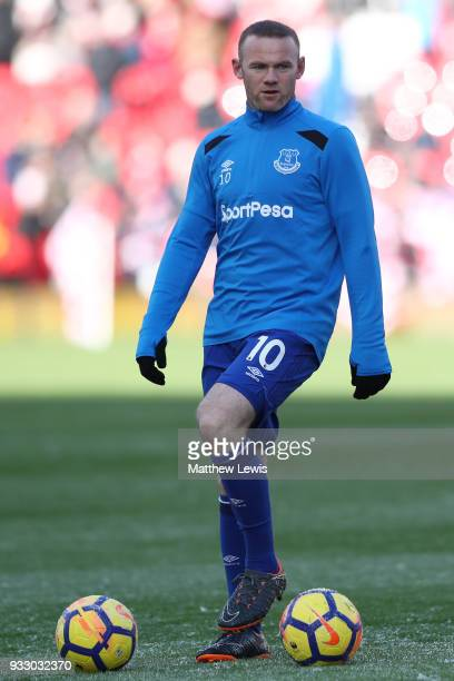 Wayne Rooney of Everton warms up ahead of the Premier League match between Stoke City and Everton at Bet365 Stadium on March 17 2018 in Stoke on...