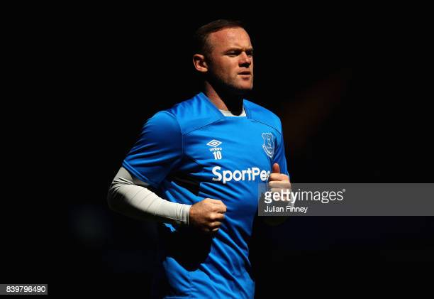 Wayne Rooney of Everton warms up prior to the Premier League match between Chelsea and Everton at Stamford Bridge on August 27 2017 in London England
