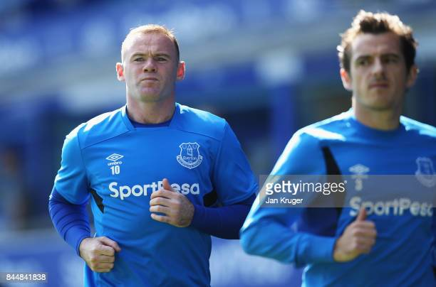 Wayne Rooney of Everton warms up prior to the Premier League match between Everton and Tottenham Hotspur at Goodison Park on September 9 2017 in...