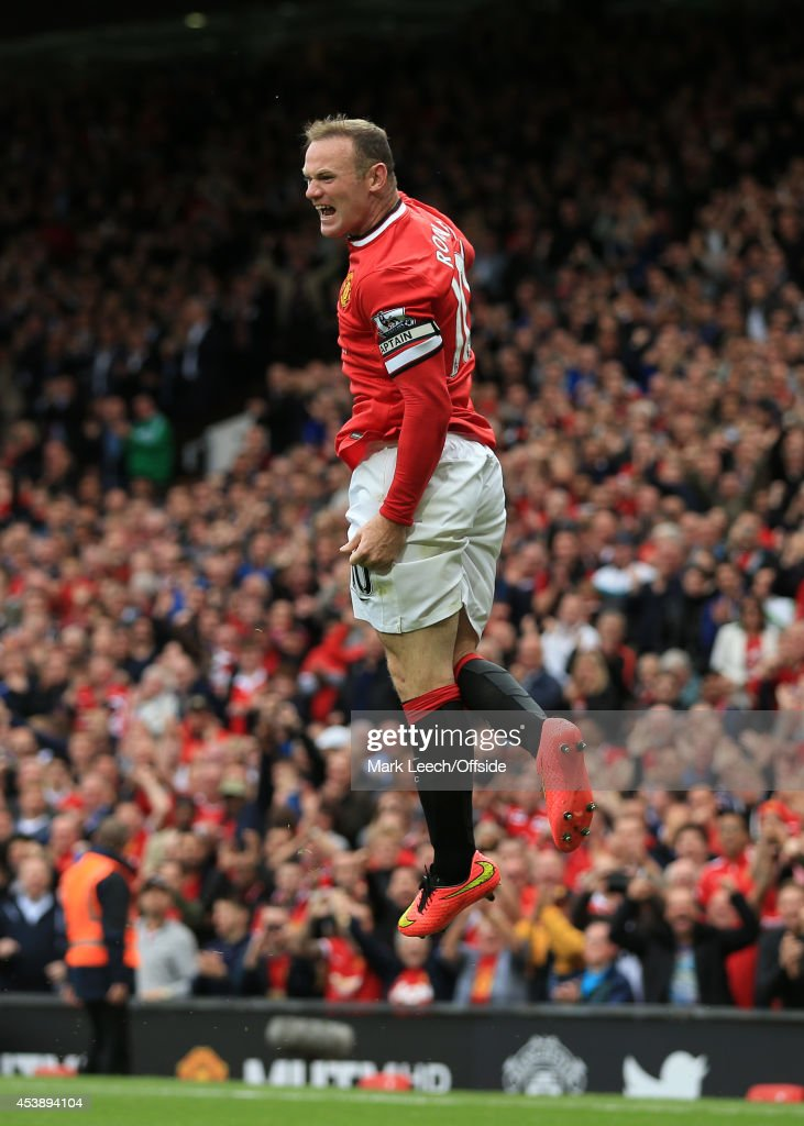 Wayne Rooney of Man Utd (R) celebrates after scoring their 1st goal during the Barclays Premier League match between Manchester United and Swansea City at Old Trafford on August 16, 2014 in Manchester, England.