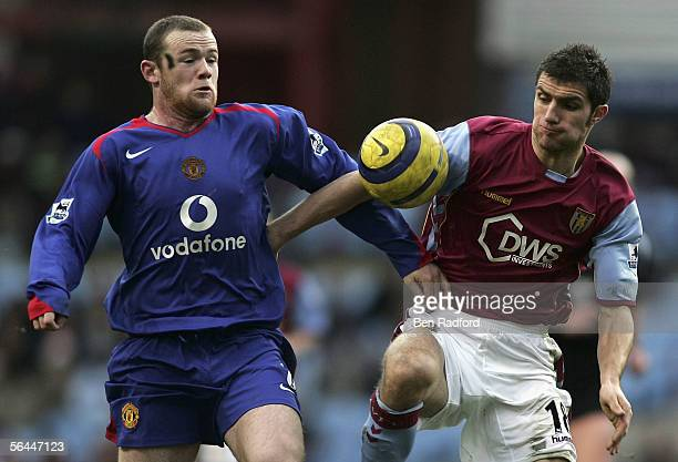 Wayne Rooney of Manchester and Aaron Hughes of Aston Villa in action during the Barclay's Premiership match between Aston Villa and Manchester Utd at...