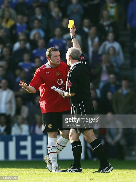 Wayne Rooney of Manchester gets a yellow card from referee Neil Barry during the Barclays Premiership match between Portsmouth and Manchester United...