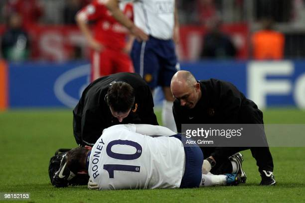 Wayne Rooney of Manchester receives treatment during the UEFA Champions League quarter final first leg match between Bayern Muenchen and Manchester...