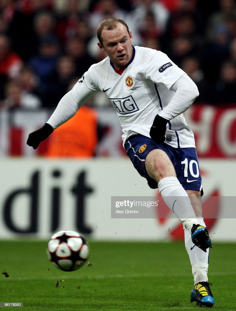 Wayne Rooney of Manchester shoots the ball during the UEFA Champions League quarter final first leg match between Bayern Muenchen and Manchester United at the Allianz Arena on March 30, 2010 in Munich, Germany.