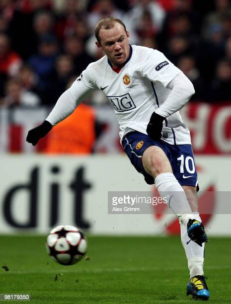 Wayne Rooney of Manchester shoots the ball during the UEFA Champions League quarter final first leg match between Bayern Muenchen and Manchester...