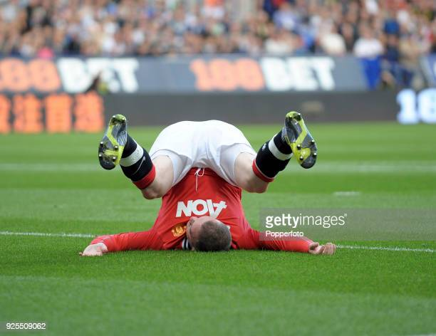 Wayne Rooney of Manchester United after falling during the Barclays Premier League match between Bolton Wanderers and Manchester United at the Reebok...