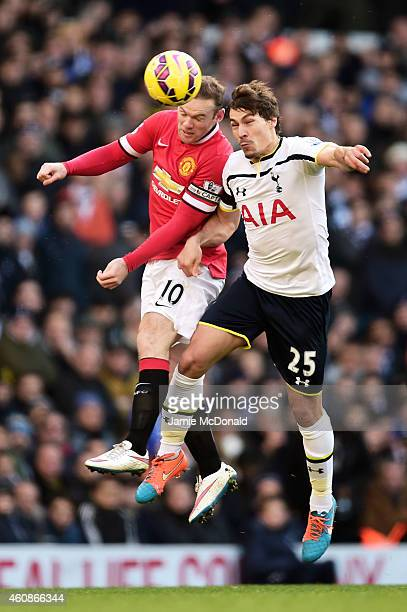 Wayne Rooney of Manchester United and Benjamin Stambouli of Spurs compete for a header during the Barclays Premier League match between Tottenham...