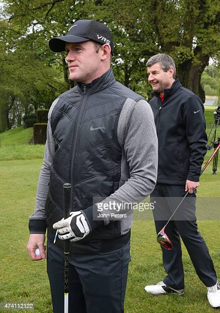 Wayne Rooney of Manchester United and Denis Irwin take part in the annual Manchester United golf day at Mere Golf Club on May 20 2015 in Knutsford...