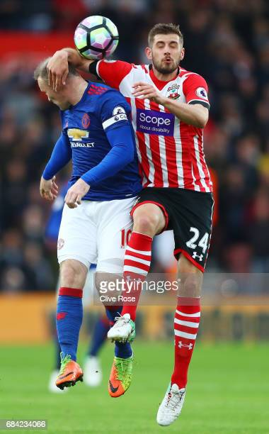 Wayne Rooney of Manchester United and Jack Stephens of Southampton battle for possession during the Premier League match between Southampton and...