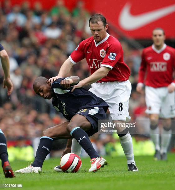Wayne Rooney of Manchester United and Luis Boa Morte of West Ham United battle for the ball during the Barclays Premiership match between Manchester...