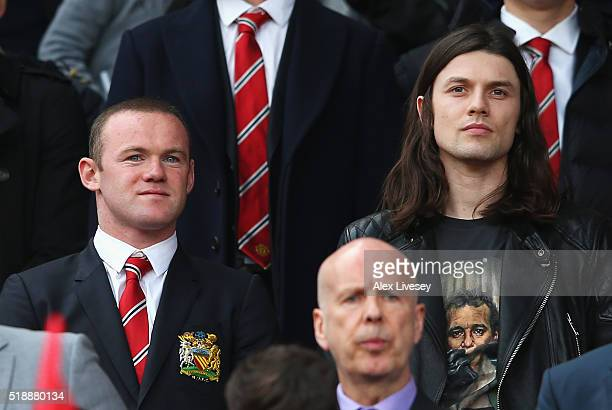 Wayne Rooney of Manchester United and musician James Bay look on from the stands prior to the Barclays Premier League match between Manchester United...