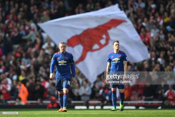 Wayne Rooney of Manchester United and Phil Jones of Manchester United are dejected after Arsenal's second goal during the Premier League match...