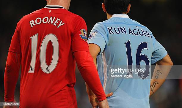 Wayne Rooney of Manchester United and Sergio Aguero of Manchester City during the Barclays Premier League match between Manchester City and...
