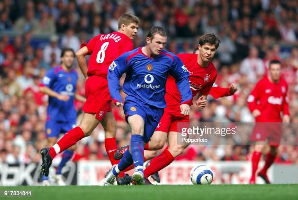 Wayne Rooney of Manchester United and Steven Gerrard of Liverpool in action during the Barclays Premiership match between Liverpool and Manchester...