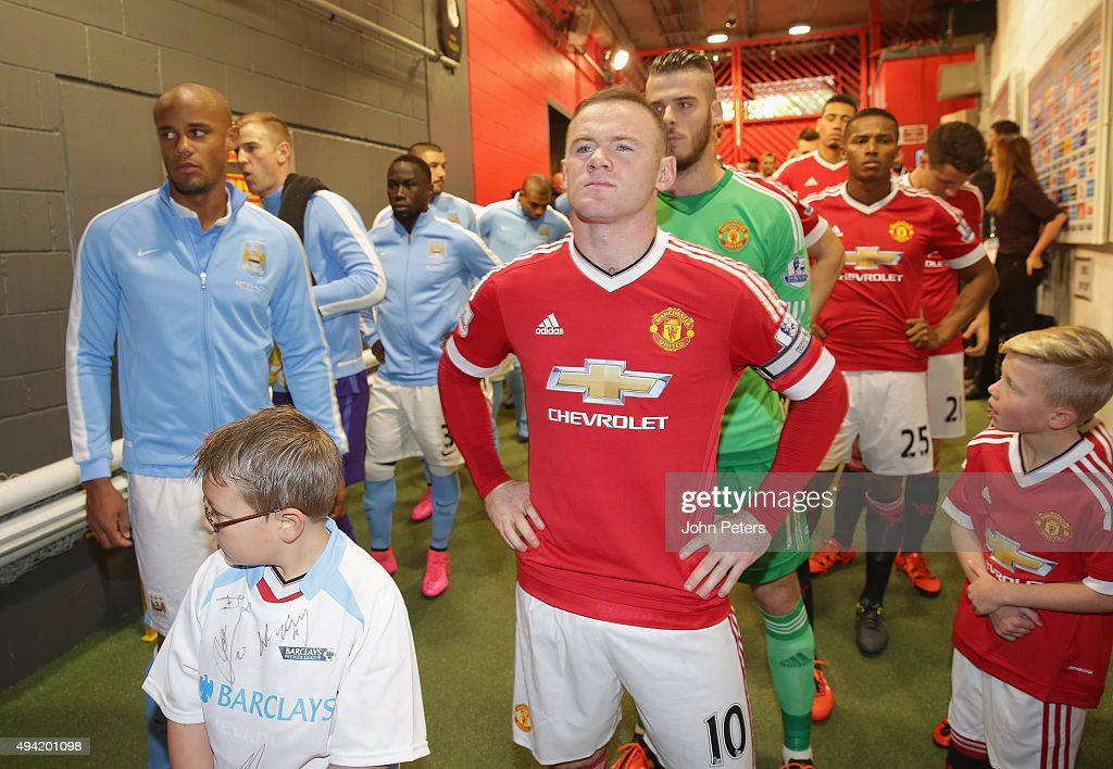 Wayne Rooney of Manchester United and Vincent Kompany of Manchester City lead the teams out ahead of the Barclays Premier League match between Manchester United and Manchester City at Old Trafford on October 25, 2015 in Manchester, England.