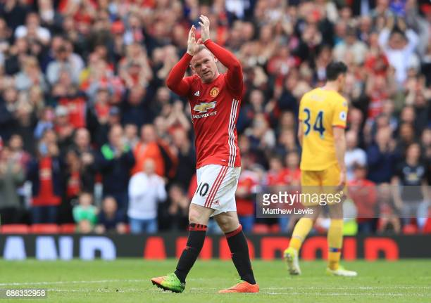 Wayne Rooney of Manchester United applauds supporters as he is subtituted during the Premier League match between Manchester United and Crystal...