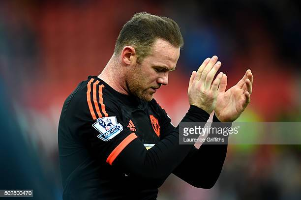 Wayne Rooney of Manchester United applauds the fans as he leaves the pitch after the Barclays Premier League match between Stoke City and Manchester...