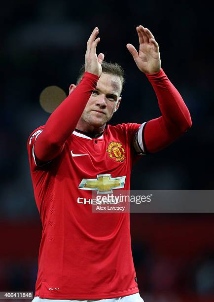 Wayne Rooney of Manchester United applauds the fans following their 30 victory during the Barclays Premier League match between Manchester United and...