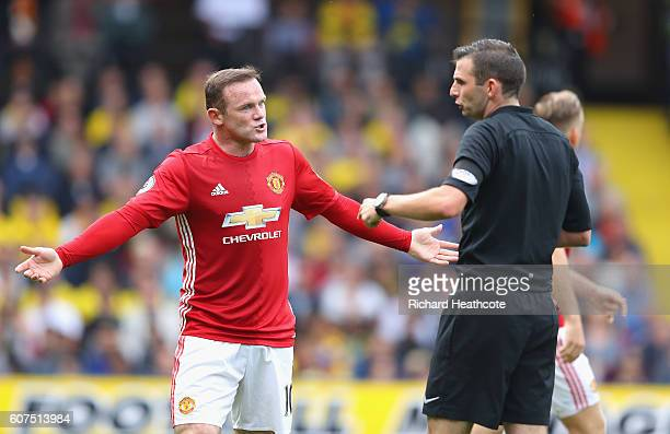 Wayne Rooney of Manchester United argues with referee Michael Oliver during the Premier League match between Watford and Manchester United at...