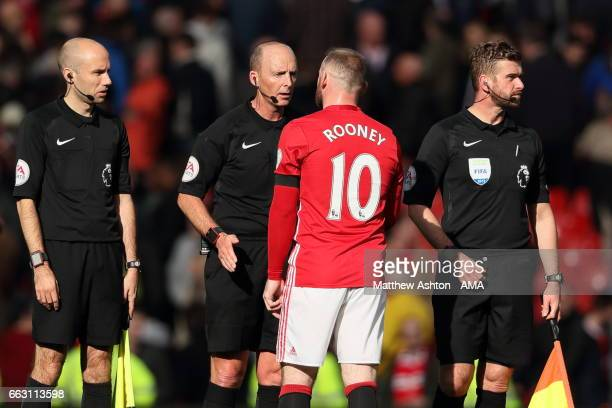 Wayne Rooney of Manchester United argues with Referee Mike Dean during the Premier League match between Manchester United and West Bromwich Albion at...