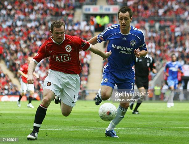 Wayne Rooney of Manchester United battles with John Terry of Chelsea during the FA Cup Final match sponsored by EON between Manchester United and...