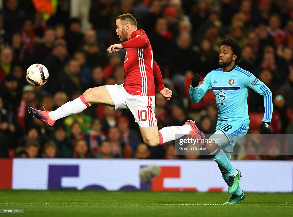 Wayne Rooney of Manchester United beats Miquel Nelom of Feyenoord to the ball during the UEFA Europa League Group A match between Manchester United FC and Feyenoord at Old Trafford on November 24, 2016 in Manchester, England.
