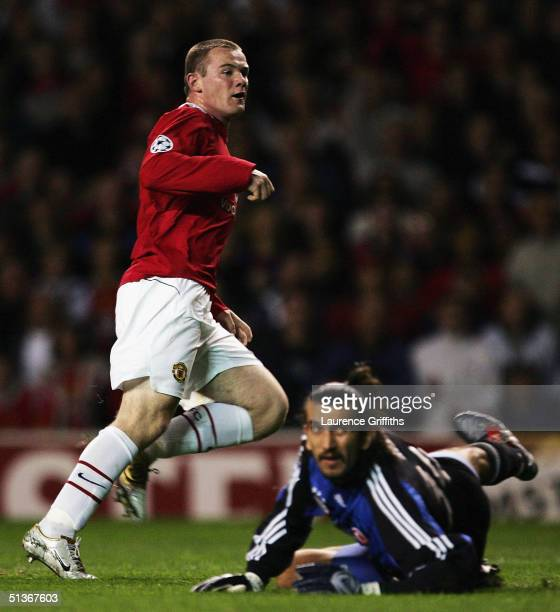 Wayne Rooney of Manchester United beats Rustu Recber of Fenerbahce to score his first goal during the UEFA Champions League Group D match between...