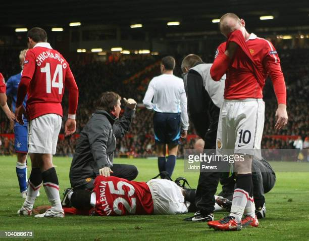 Wayne Rooney of Manchester United cannot look as Antonio Valencia lies injured during the UEFA Champions League Group C match between Manchester...