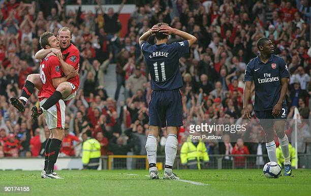 Wayne Rooney of Manchester United celebrates Abou Diaby of Arsenal scoring an owngoal during the Barclays Premier League match between Manchester...
