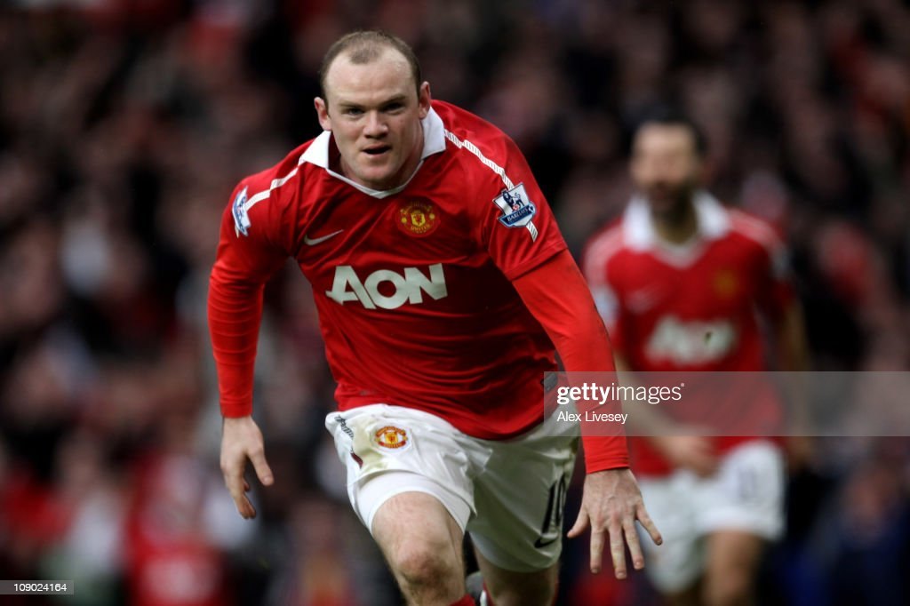 Wayne Rooney of Manchester United celebrates after he scores a goal from an overhead kick during the Barclays Premier League match between Manchester United and Manchester City at Old Trafford on February 12, 2011 in Manchester, England.