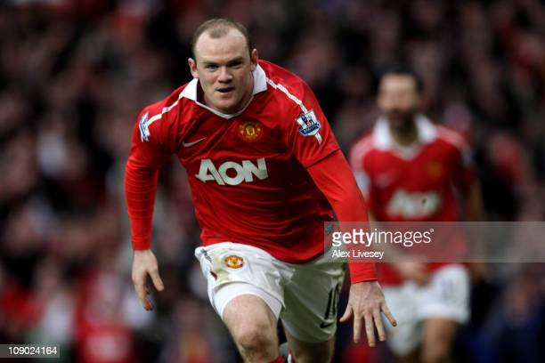 Wayne Rooney of Manchester United celebrates after he scores a goal from an overhead kick during the Barclays Premier League match between Manchester...