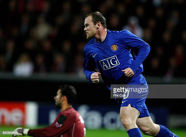 Wayne Rooney of Manchester United celebrates after scoring during the UEFA Champions League Group E match between Aalborg BK and Manchester United at...