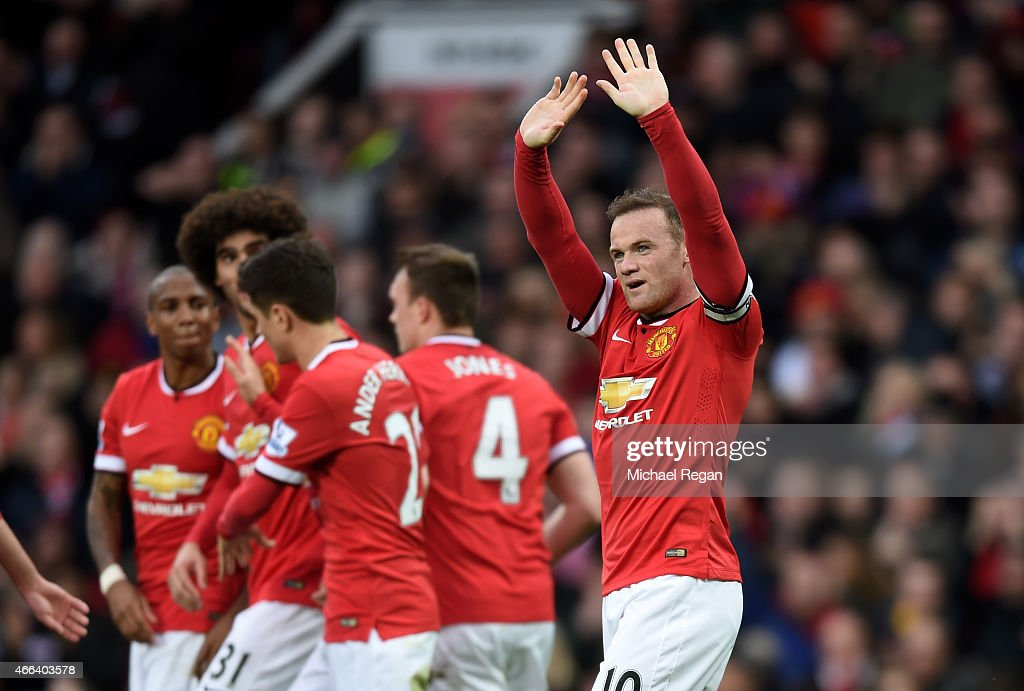 Wayne Rooney of Manchester United celebrates after scoring his team's third goal during the Barclays Premier League match between Manchester United and Tottenham Hotspur at Old Trafford on March 15, 2015 in Manchester, England.