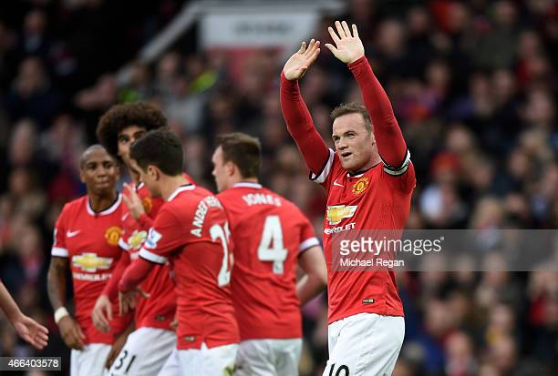 Wayne Rooney of Manchester United celebrates after scoring his team's third goal during the Barclays Premier League match between Manchester United...