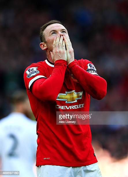 Wayne Rooney of Manchester United celebrates after scoring his team's second goal during the Barclays Premier League match between Manchester United...