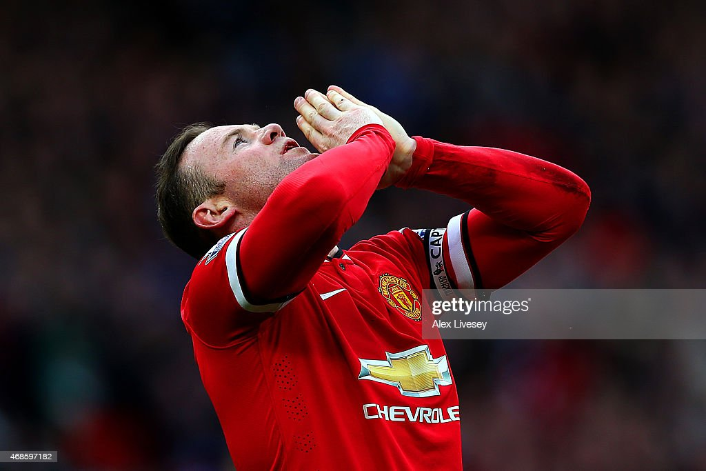 Wayne Rooney of Manchester United celebrates after scoring his team's second goal during the Barclays Premier League match between Manchester United and Aston Villa at Old Trafford on April 4, 2015 in Manchester, England.