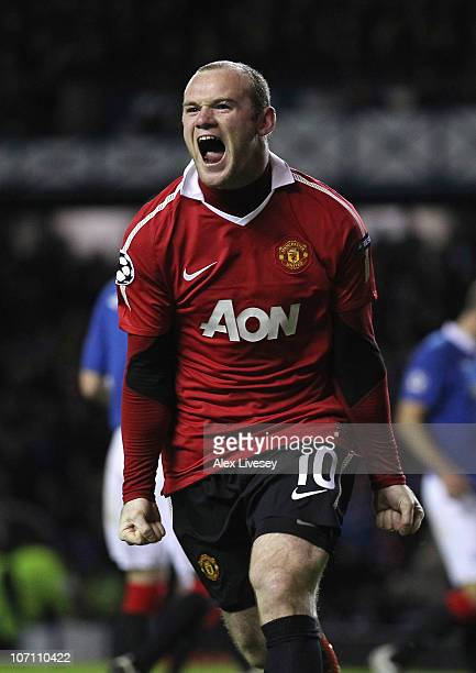 Wayne Rooney of Manchester United celebrates after scoring the winning goal from the penalty spot during the UEFA Champions League Group C match...