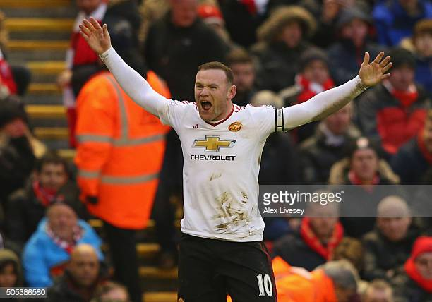 Wayne Rooney of Manchester United celebrates after scoring the winning goal during the Barclays Premier League match between Liverpool and Manchester...