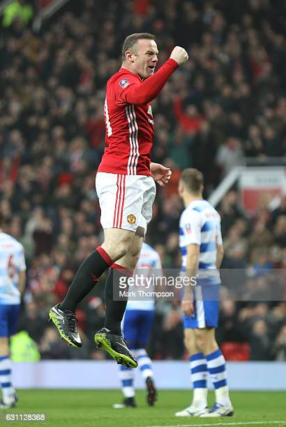 Wayne Rooney of Manchester United celebrates as he scores his sides first goal during the Emirates FA Cup third round match between Manchester United...