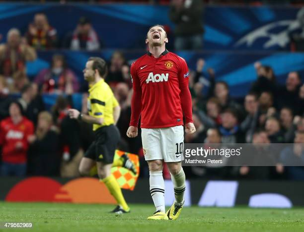 Wayne Rooney of Manchester United celebrates at the final whistle during the UEFA Champions League Round of 16 second leg match between Manchester...