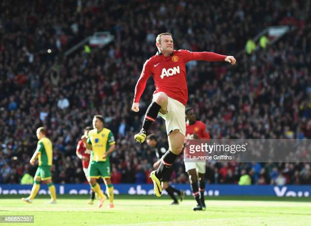 Wayne Rooney of Manchester United celebrates his first half penalty during the Barclays Premier League match between Manchester United and Norwich...