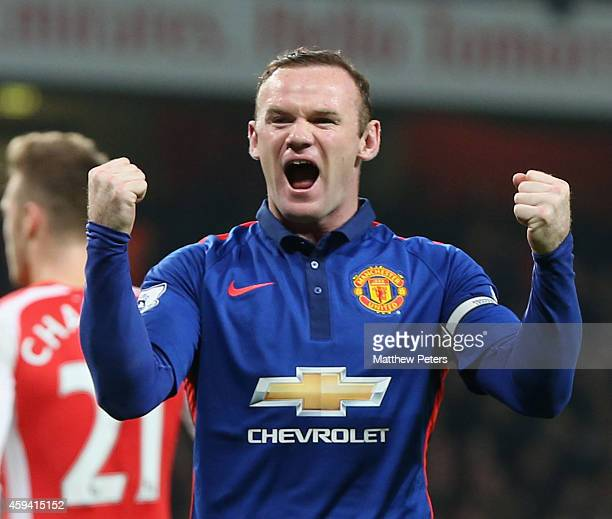 Wayne Rooney of Manchester United celebrates Kieran Gibbs of Arsenal scoring an owngoal during the Barclays Premier League match between Arsenal and...