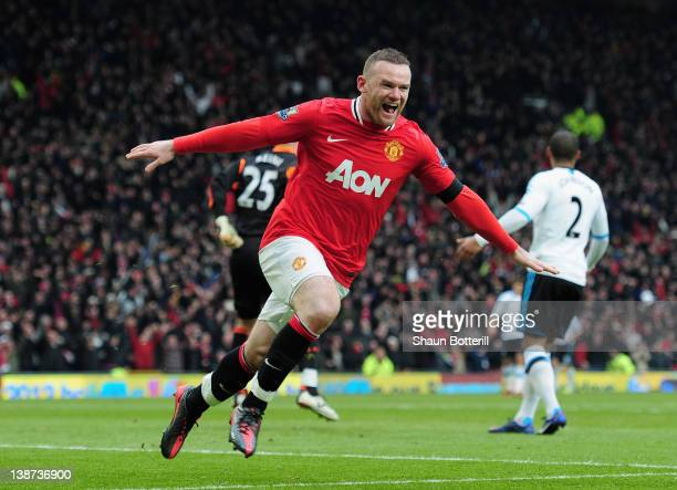 Wayne Rooney of Manchester United celebrates scoring his second goal during the Barclays Premier League match between Manchester United and Liverpool...